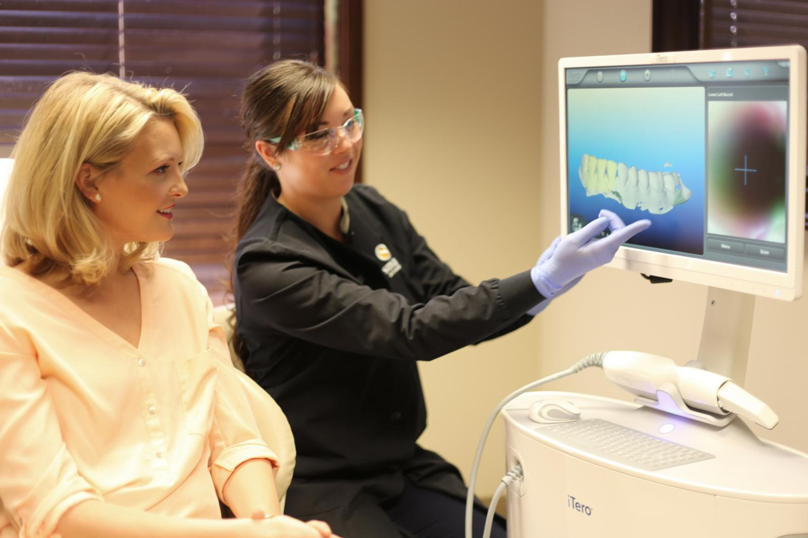 Woman learning about oral health on a computer