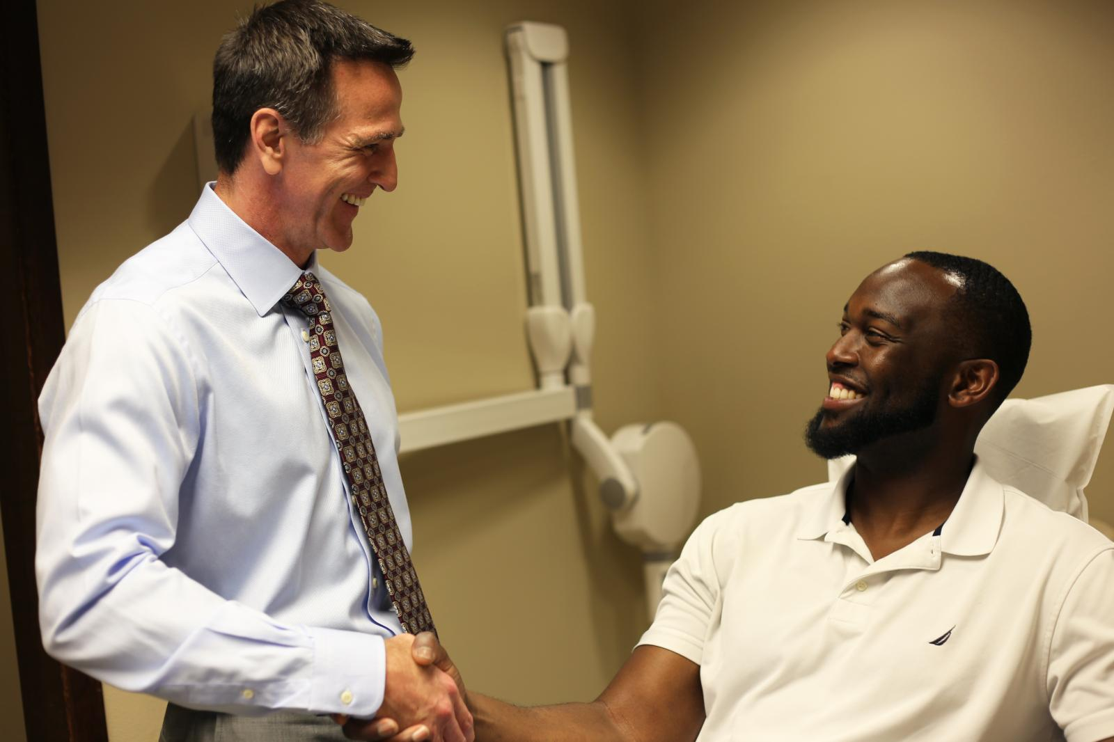 Man shaking orthodontists hand